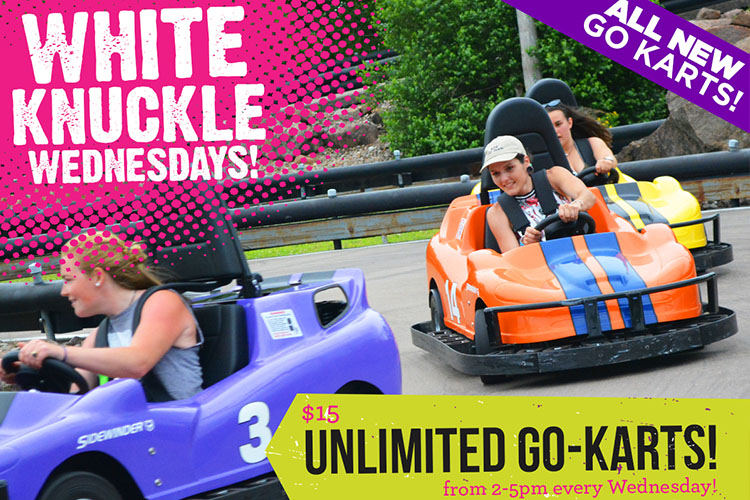 Three guests enjoying a ride on Calypso's Go-Kart track. $15 unlimited Go-Karts every Wednesday from 2-5pm.