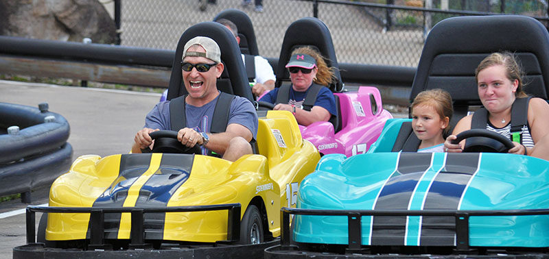 Guests enjoying a Go-Kart ride on the track at Calypso's.